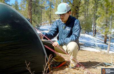 Rab Xenon XTechnical Hoodie setting up tent