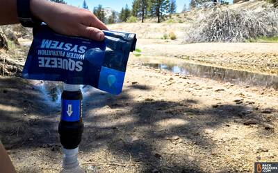 Sawyer-Squeeze-Water-Filter-review-filtering-with-rolled-up-bag