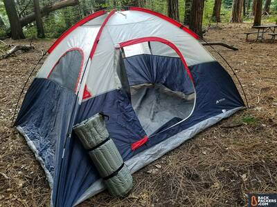 rei-camp-bed-3.5-review-rolled-up-next-to-tent