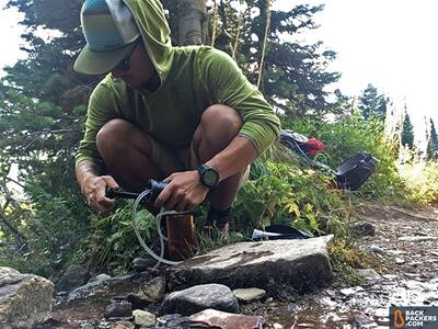 Katadyn-Hiker-Pro-review-pumping-in-stream