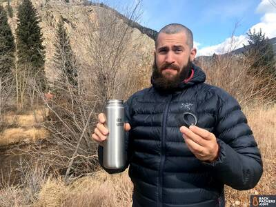 Klean-Kanteen-Wide-Mouth-review-holding-bottle-and-cap