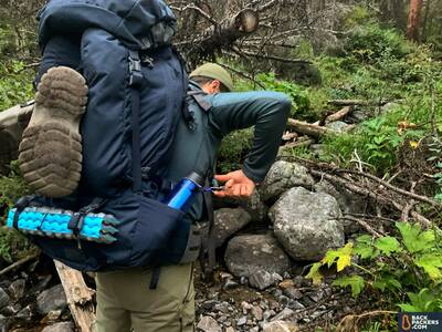 Mystery-Ranch-Glacier-closeup-of-pack-while-hiking-water-bottle-pocket