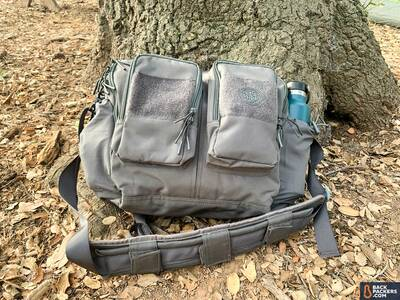 Beretta-Tactical-Messenger-Bag-laying-down-on-leaves