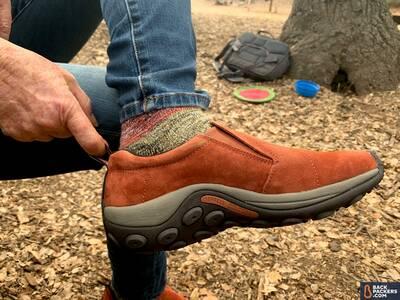 Merrell-Jungle-Moc-pulling-shoe-on