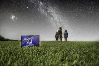 outdoor gear for kids subscription box in front, kids stargazing in back