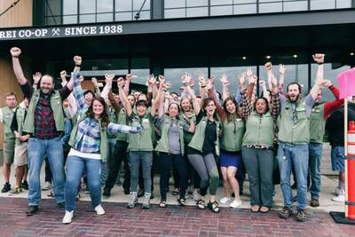 Happy employees excited to welcome guests to REI
